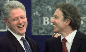 "BELFAST, -: (FILES) US President Bill Clinton (L) is introduced by British Prime Minister Tony Blair during a ground-breaking ceremony for Springvale Educational Village in Belfast, Northern Ireland. Blair was showered with praise and also a few brickbats 10 May 2007 as he announced his 10 years in power would end June 27, but even his opponents conceded he is a ""formidable"" politician. Blair was praised for his role in bringing peace to Northern Ireland but condemned for taking Britain into a divisive war in Iraq, while his domestic policies drew mixed feelings from both inside and outside his Labour Party. AFP PHOTO Joyce NALTCHAYAN (Photo credit should read JOYCE NALTCHAYAN/AFP/Getty Images)"
